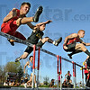 They're off: South's Kenny Payne (L) , South Vermillion's Russell Peelman and John Haley of South clear the first hurdle during the 110M hurdles event Friday night. Haley was the eventual winner of the event during the South Invitational Track Meet.