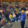 WhatamIbid: Auctioneer Johnny Swalls takes on the role of ringman, holding a peanutbutter creme pie, to begin the auction at Prarie Creek Auction Friday night. Several of the areas' auctioneers took part in the event, a fundraiser fo the American Cancer Societies' Relay for Life. About 1,000 differrent items were donated for the auction.