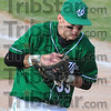 Handcuffed: West Vigo firstbaseman Aaron Welch juggles the ball momentarily after fileding a hit.