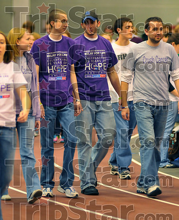 "Surviving: Cancer survivors and fellow ISU students J.D. Miller and Gabe Mullane wear their purple shirts as they walk with members of ""J.D.s Posse"" at the Relay for Life at Rose-Hulman Friday evening."