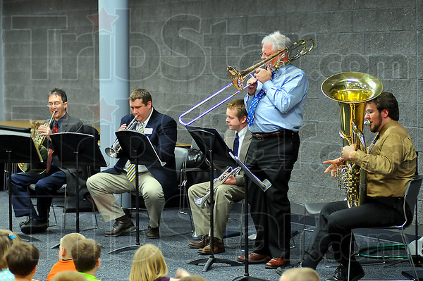 On stage: The Terre Haute Synphony's Brass Quintet performed for the students of Turkey Run Elementary School Friday afternoon. The group includes: Brian Kilp on french horn, Michael Mann and Robert Waugh on trumpet, Randy Mitchell on trombone and Alex Lapins on tuba.