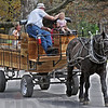 """Giddy-up: Four-year-old Chloe Kennedy gets her hair brushed-back by Larry Sample as Chloe drives """"Pete"""" around Deming Park Friday afternoon. Chloe's mother, Carrie rides in the back of the wagon with her friend Amy Creamer."""