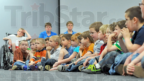 Rapt attention: Turkey Run Elementary School students listen to the Terre Haute Symphony's  Brass Quintet play Friday afternoon. The occasion was a make-up date for the students that were in a school bus accident earlier in the month.