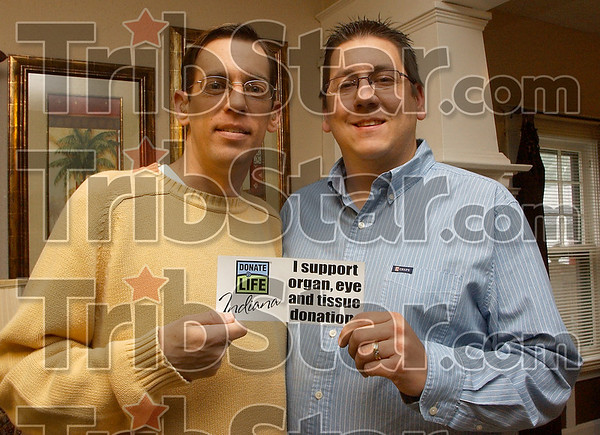 One down, one to go: David Trout and his brother Philip hold a bumper sticker supporting eye, organ and tissue donations. Philip recieved a kidney transplant in 2007 and David is waiting a suitable one to get him of dialysis.