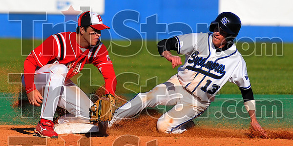 Quick enough: ISUs Ryan Strousborger slides safely into second for a stolen base. Bradley shortstop Tommy Fitzgerald fields the late throw.