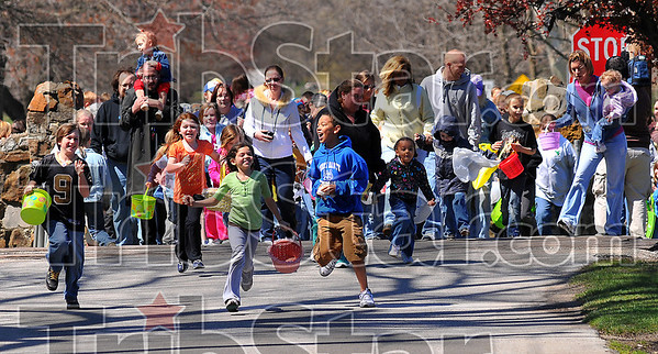 Here they come: Children bolt into Deming Park for the annual egg hunt Saturday afternoon.