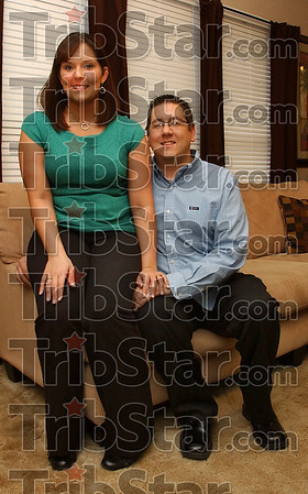 At home: Marissa and Philip Trout pose in the livingroom of their Terre Haute home. Philip underwent a successful kidney transplant in 2007.