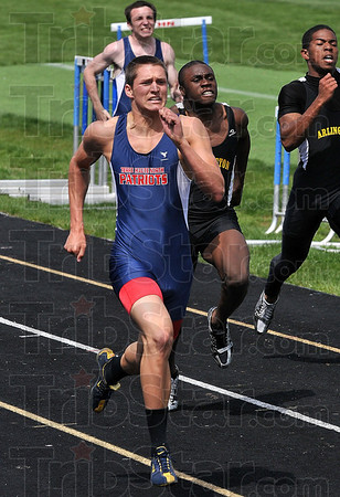 Tribune-Star/Joseph C. Garza<br /> Last race belongs to the Patriots: Terre Haute North's Scott Weatherford leads all competitors in the 200-meter dash of the Patriot Challenge Saturday at North.