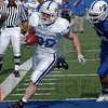 Tribune-Star/Joseph C. Garza<br /> Fleet-footed RB: Indiana State running back Reece Craig escapes the defense, including teammate Jacolby Washington (34), to score during the annual Blue/White spring game Saturday at Memorial Stadium.