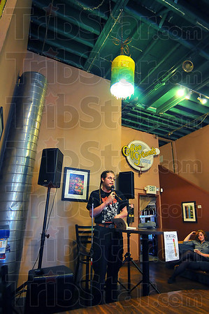 On stage: Walter Beck takes his turn at the microphone last week at the Coffee Grounds.