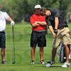 Locals: Patriot golfer John Pollack and Terre Haute South's Thomas Goss watch Northview's Austin Akers drive.