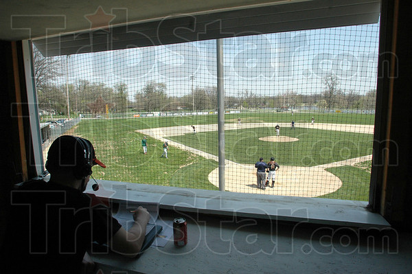 Stadium: Sportscaster B.J. Fessant covers a Paris High School baseball game Saturday afternoon in the press box of Laker Stadium.