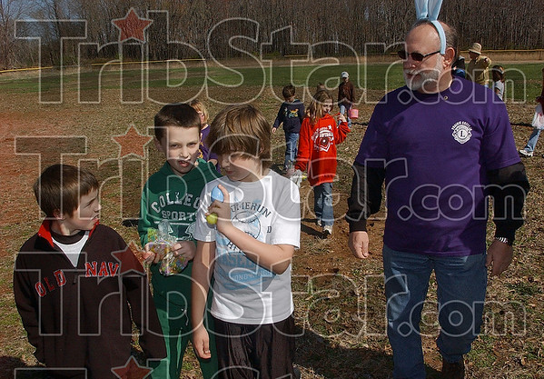 Tribune-Star/Joseph C. Garza<br /> Ten-year-old Wiley Clinkenbeard, center, white shirt, describes how he found the grand prize egg to his fellow egg hunters during the Prairie Creek Lions Club's Easter Egg Hunt Saturday at Wilson Field off of Bowen Drive.