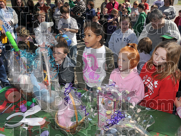 Tribune-Star/Joseph C. Garza<br /> Children participating in the Prairie Creek Lions Club Easter Egg Hunt eagerly anticipate a raffle drawing for the baskets in front of them Saturday at Wilson Field off of Bowen Drive.