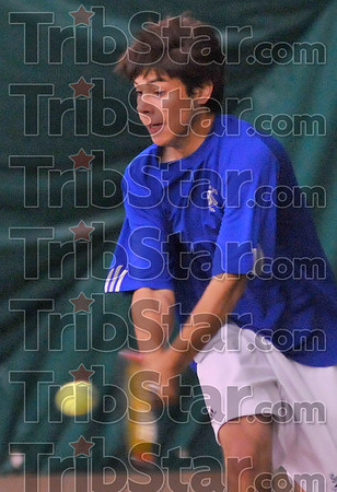 Baseline: Milos Pavlovic returns a shot in ISU tennis action against Creighton Sunday afternoon.