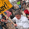 Tribune-Star/Joseph C. Garza<br /> Enough taxes already!: Paul Butler of Marshall, Ill., participates in a chant with other attendees of a tea party demonstration Wednesday on the front lawn of the Vigo County Courthouse.