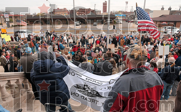Tribune-Star/Joseph C. Garza<br /> Over 200 in attendance: An attendee at the tea party demonstration on the front steps of the Vigo County Courthouse wears a flag in the back of his cap during the event Wednesday.