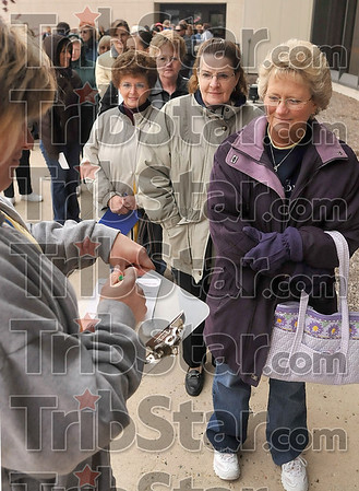 Tribune-Star/Joseph C. Garza<br /> In demand: Connie Knierim takes down information from Casey, Ill., resident Cherie Ashley as Ashley waits in line for tickets for the Sixth Annual Wabash Valley Ladies Unity Night Wednesday outside of Hulman Center.