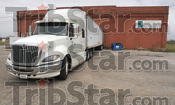 Tribune-Star/Joseph C. Garza<br /> Loaded with poison: A semi tractor trailer is loaded by the Environmental Protection Agency with chemicals found in one of the buildings of Wabash Environmental Technologies Tuesday off of First Street.