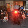 1000 words: Missionary to Africa Ed Buell gave a short slide presentation of life in the Congo to several Riley Elementary School students that participated in the effort to collect toys and games to send to children in the Congo. Buell is raising money to purchase and send a portable sawmill to the Congo, where he and his wife Brenda have worked for years. The toys and other hard to come by items will be sent in the extra room in the shipping container.