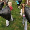 Tribune-Star/Joseph C. Garza<br /> Team work: Students in Gail Nattkemper's fifth-grade class carry bags of brush collected on the front lawn of Farmersburg Elementary Wednesday as part of Earth Day.