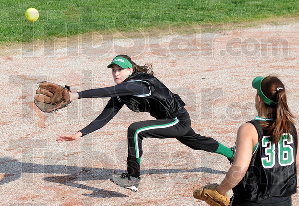 Got it: West Vigo shortstop #4, Cassidy Carlson runs down a blooper over third baseman Brittney Hall's head and makes the out during game action against Terre Haute South Wednesday evening.