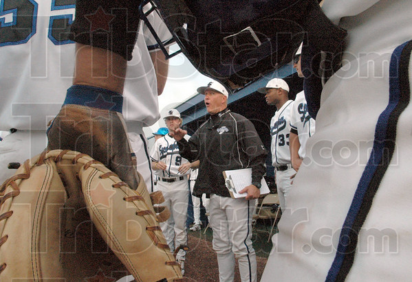 Let's go: Indiana State University head coach Lindsay Meggs has a little chat with his team as they fall behind Illinois in the early innings of Wednesday's game. The Sycamores rallied to take the lead in the later innings.