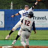 High throw: Indiana State shortstop Ben Ferrell leaps to attempt to catch a high throw to second base during game action with Illinois Wednesday night at Sycamore Field. The runner Brandon Wikoff was safe on the play.