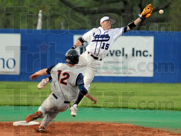 Stretch: Indiana State shortstop stretches to attempt to catch a high throw during game action with Illinois Wednesday night at Sycamore Field. The runner Brandon Wikoff was safe on the play.