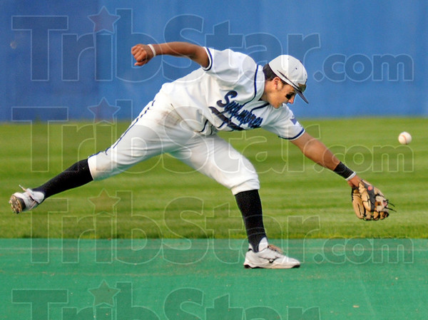 Too hot: Indiana State second baseman #5, Brian Ramirez can't quite get to a hard hit ball during game action against Illinois Wednesday night at Sycamore Field.