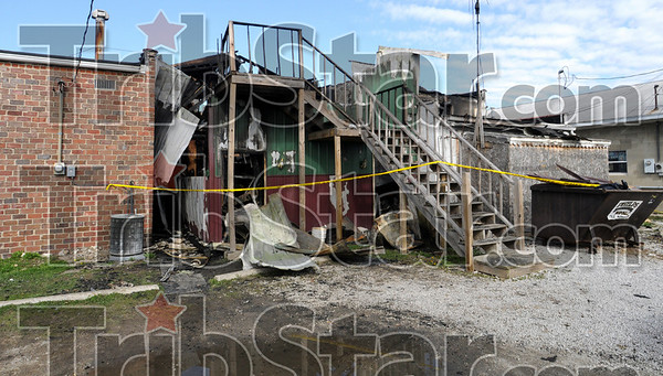 Destroyed: The remains of the only bar in Dana, Indiana stand between the Town Hall (L) and the fire department (R) after a fire destroyed the business just after midnight Monday.