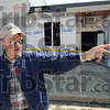 Resident: Retired school bus driver Paul Conner talks about living his life in the small town of Dana, Indiana Wednesday afternoon as he stands outside the bar that burned late Monday night.