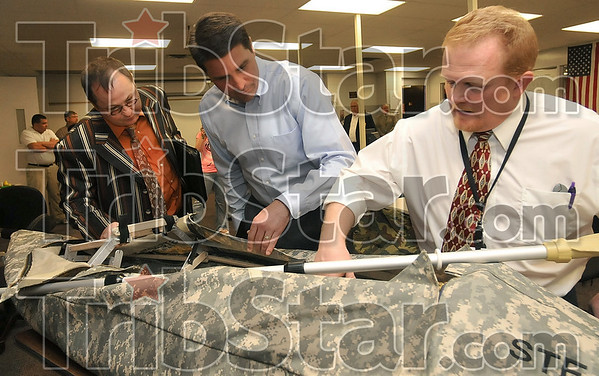 Tribune-Star/Joseph C. Garza<br /> Technology put to use: Terre Haute South teacher Steve Joseph, right, shows Congressman Brad Ellsworth, center, and Vigo County School Corporation Curriculum Coordinator/Career & Technical Education Director Doug Dillion a raft design created by student Gage Wilkinson Monday at South.