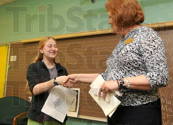Tribune-Star/Joseph C. Garza<br /> Award-winning art: Meadows Elementary School fifth-grader Gwen Van Denburg is congratulated by Principal Susan Newton after Van Denburg won the regional Indiana Urban Forest Council 2009 Arbor Day Poster Contest.