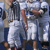 Tribune-Star/Joseph C. Garza<br /> It counts: Indiana State's Ryan Roberts, center, is congratulated by teammates as an official signals a touchdown that he scored during the annual Blue/White spring game Saturday at Memorial Stadium.