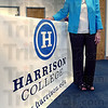 New name: Pat Mozley, Regional Director for Harrison College stands by the new signage at the campus on State Road 46.