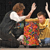 Keeping the beat: Bethann Smith helps Terre Haute North's Cody Kuhn keep time on the drums.