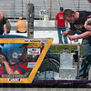 Race preparation: Sullivan High School sophomore Skyler Thacker works on the school's super mileage vehicle as driver Cole Chickadaunce and teammate Matt Migliorini wait for the start of the next ten-lap series of the 2009 IMSTEA Super Mileage Challenge Monday at O'Reilly Raceway Park in Indianapolis.