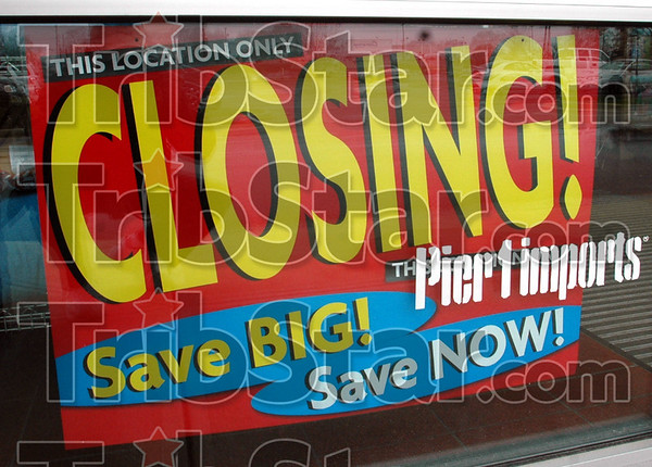 Closing: Detail of sign in the window of the Terre Haute Pier 1 Imports store.