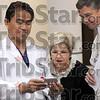 Award winner: Dr. Primo Andreas (L) shows a digital image of his new granddaughter to Regional Hospital CN0 Carolyn Hamilton and CEO Chris Hill just prior to an awards presentation Monday afternoon.