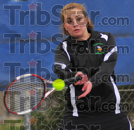 Tough time: West Vigo's #1 player Taylor Brown returns a ball hit by Brittany Farmer of Terre Haute North. Farmer won the match 6-0, 6-0.