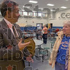 Issues: Terre Haute mayor Duke Bennett talks about the big blue trash cans with Marie Engles prior to the start of the town Hall meeting Tuesday night at Terre Town Elementary School.