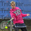 In the pink: Terre Haute North #1 singles player Brittany Farmer signed her national letter of intent today, deciding to play tennis at Butler. Here she returns a ball against Taylor Brown in their cross county match on the Patriots court.