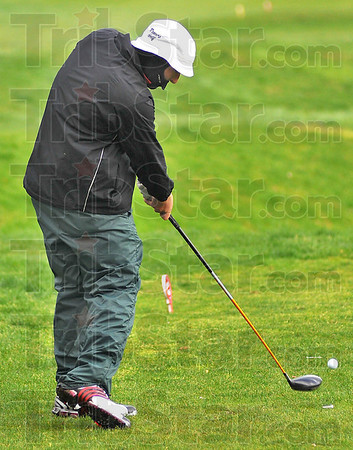 Home stretch: Terre Haute South golfer Zach Hosking hits from the ninth tee at the Landing.