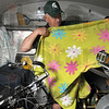 Tribune-Star/Joseph C. Garza<br /> Bikes and blankets: Dick Comar of Okemos, Mich., and a former Indiana State football defensive line coach, shows off one of the blankets that he and his fellow riders are taking to Shinsky Orphanage in Mexico.