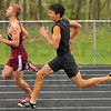 New record: James Craigmyle (in black)set a new South Vermillion High School record for the 400 meter run Monday night at Riverton-Parke. He won easily with a time of 51 seconds flat.