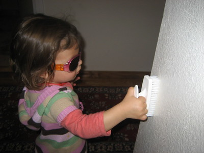 Mia Brushing House Clean with Sunglasses for Glare