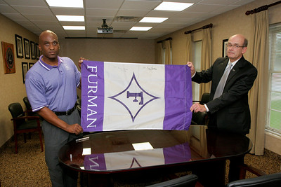 Dr. Bonner signs a Furman University Flag; August 12, 2009.