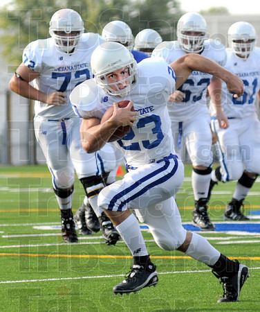 Looking: Indiana State's #23, Bryan Stefanik looks for some running room during Thursday's Blue/White scrimmage at Memorial Stadium.