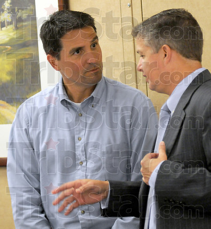 Listening: Congressman Brad Ellsworth listens to Regional Hospital CEO Chris Hill after meeting with doctors and other health care staff privately Thursday afternoon.